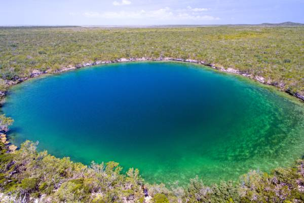 aerial view of giant saline Karst blue hole on East Caicos