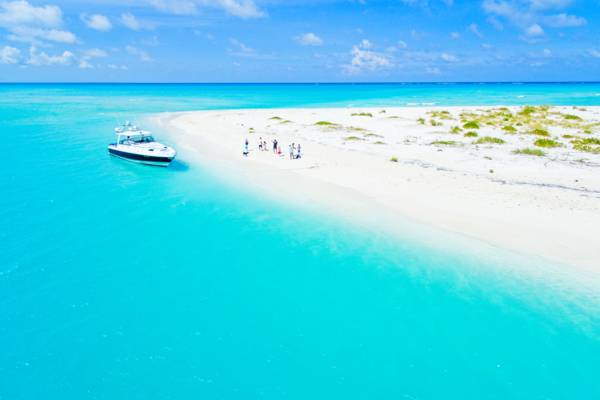 aerial view of the beach at Fort George Cay and a private yacht charter