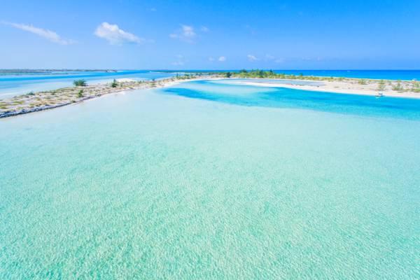 aerial photo of clear ocean water at Half Moon Bay lagoon