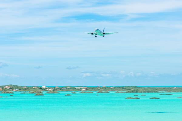 airliner on approach to the PLS airport over Chalk Sound on Providenciales
