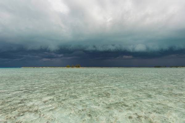 storm clouds over Water Cay and Little Water Cay