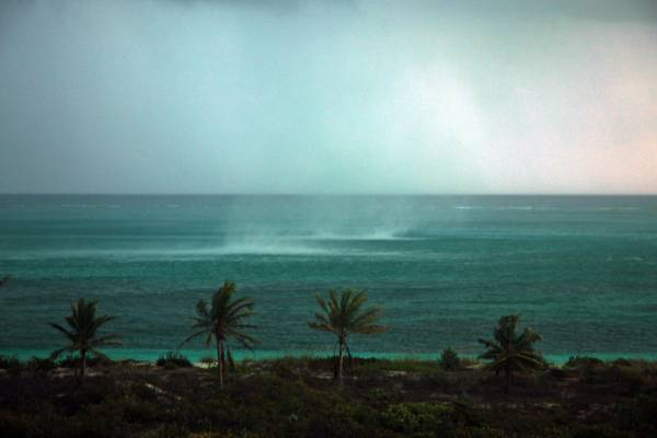 water spouts forming at the Bight Beach on Providenciales