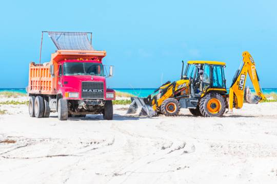 dump truck and JCB 3DX backhoe at Leeward Beach on Providenciales