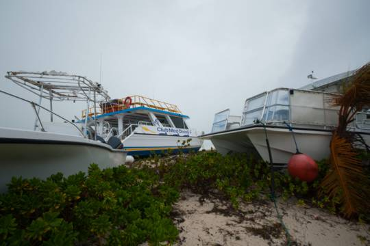 dive boats washed on land after Hurricane Hanna