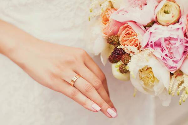 bride with ring and flower bouquet