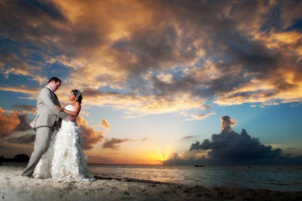 sunset photo on Grace Bay Beach with bride and groom