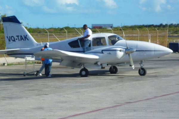 Caicos Express Piper Aztec on the tarmac at the Providenciales International Airport