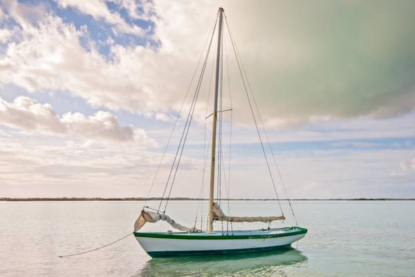 small Caicos Sloop on the calm water at Chalk Sound