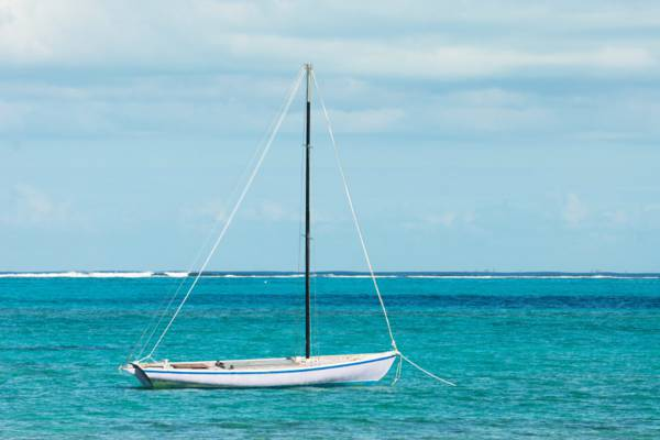 Caicos Sloop moored off the beach at Blue Hills settlement on Providenciales