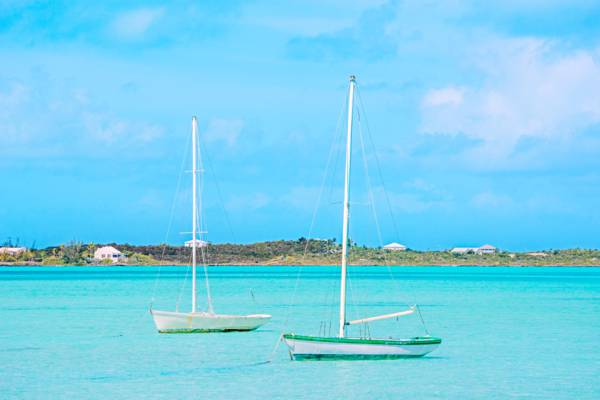 two small Caicos Sloops anchored in Chalk Sound lagoon