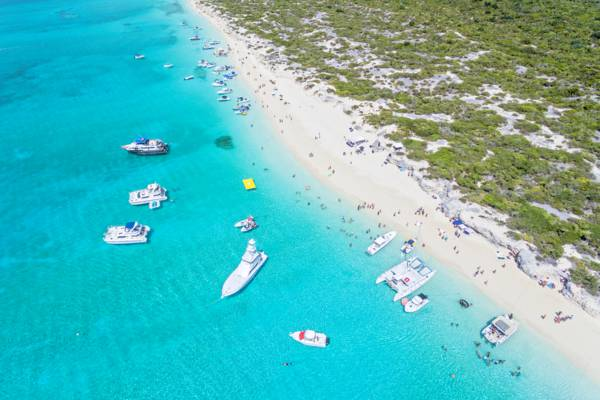 aerial photograph of boats at Water Cay during the Caribbean House Evolution party