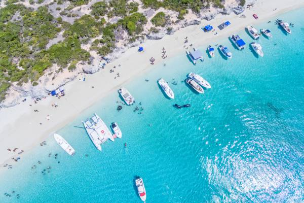 aerial view of a boat party at Water Cay in the Turks and Caicos