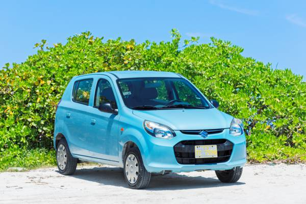 compact Suzuki rental car at Leeward Beach