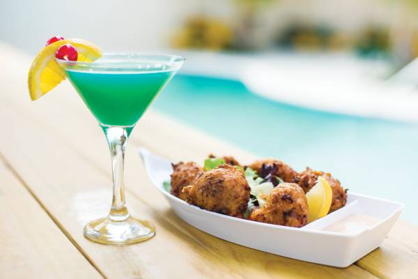conch fritters and cocktail at Coconut Grove Restaurant