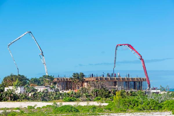 concrete pump trucks at a home construction site in the Turks and Caicos