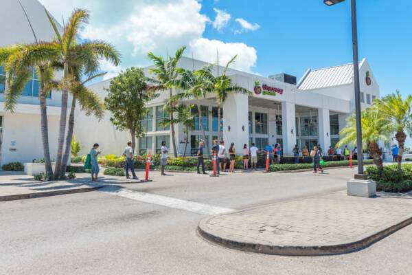 queue spacing at a supermarket in the Turks and Caicos to reduce transmission of COVID-19