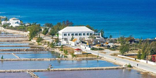 aerial photo of the Salt Cay Salinas, the Harriott White House, and Victoria Street
