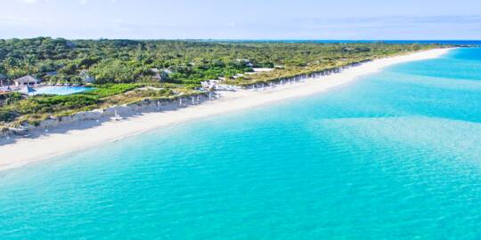 the beautiful beach and turquoise water at Parrot Cay Resort