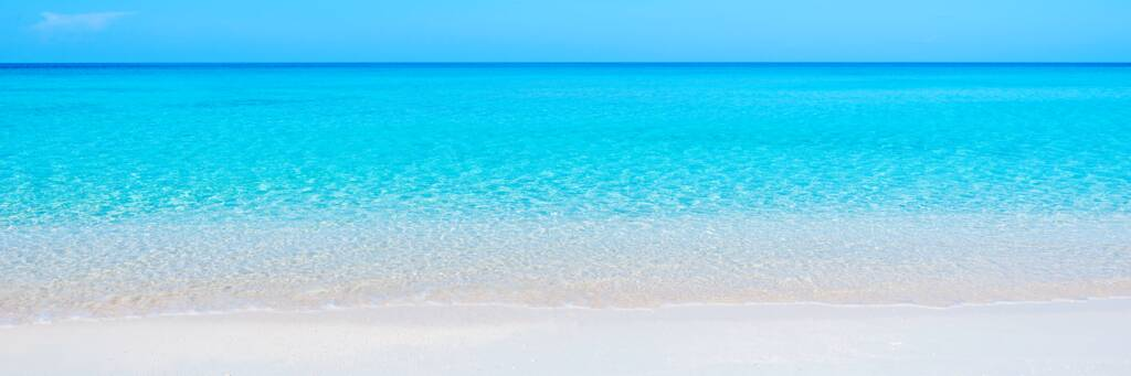 white sand and calm turquoise ocean at Governor's Beach in the Turks and Caicos