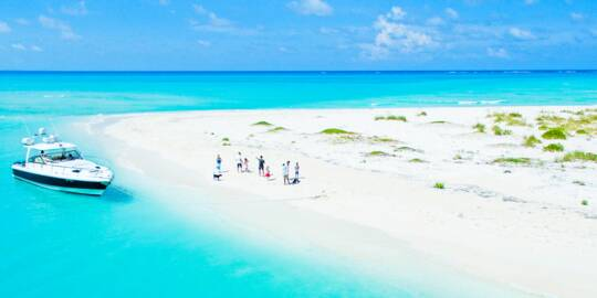 luxury boat charter at Fort George Cay