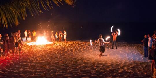 fire dancing and bonfire at Long Bay Beach