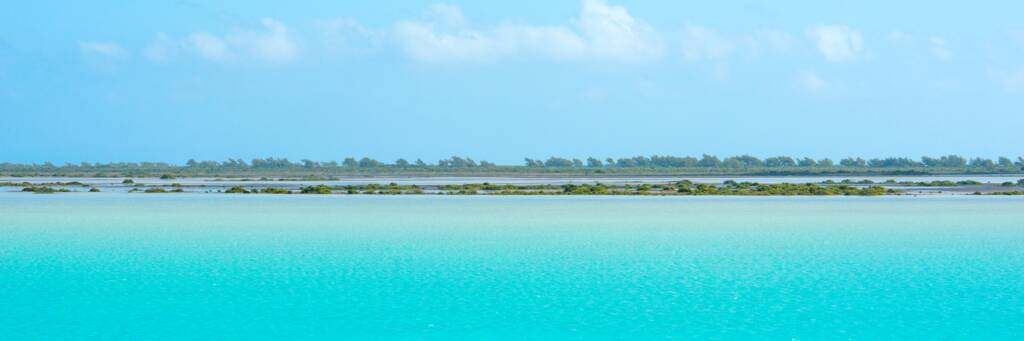 incredible turquoise water and Bay Cay at Bottle Creek Lagoon