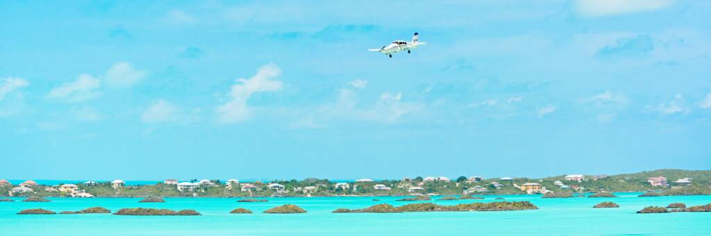 Caicos Express Piper Aztec over Chalk Sound in the Turks and Caicos