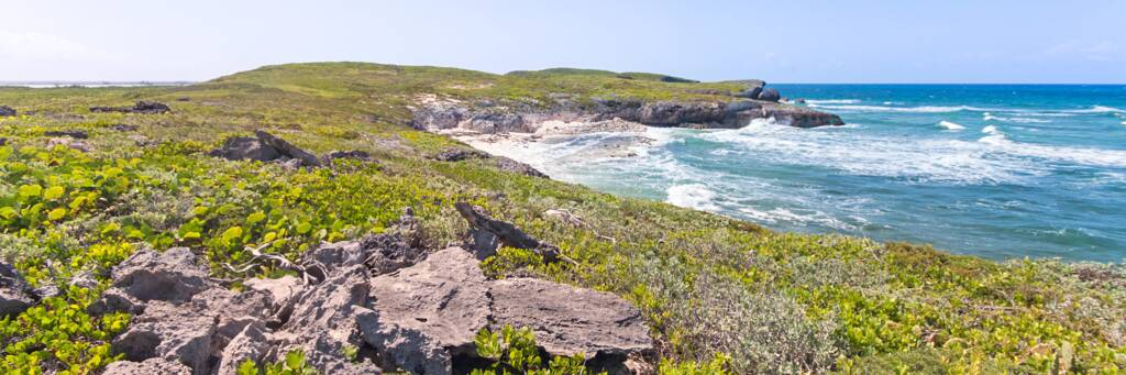 Waves crashing on the rugged cliffs at Norbellis Coves on Middle Caicos.