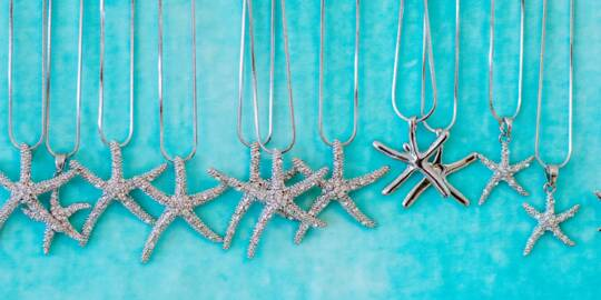 silver starfish necklaces in a Grace Bay gift shop