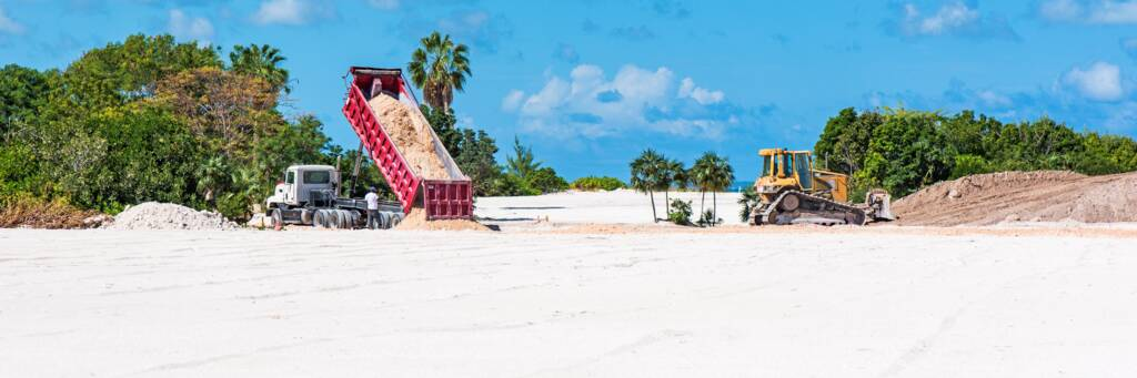 dump truck and bulldozer working at Leeward on Providenciales