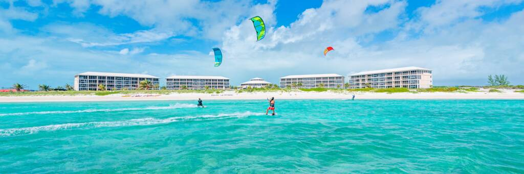 kiteboarders on the beautiful turquoise waters fronting the East Bay Resort