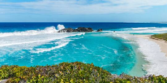 Waves crashing onto Dragon Cay, a small island in the bay at Mudjin Harbour, Middle Caicos.