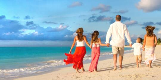 family photography session on Grace Bay Beach at sunset