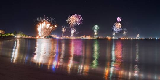 fireworks at night over Grace Bay Beach and resorts