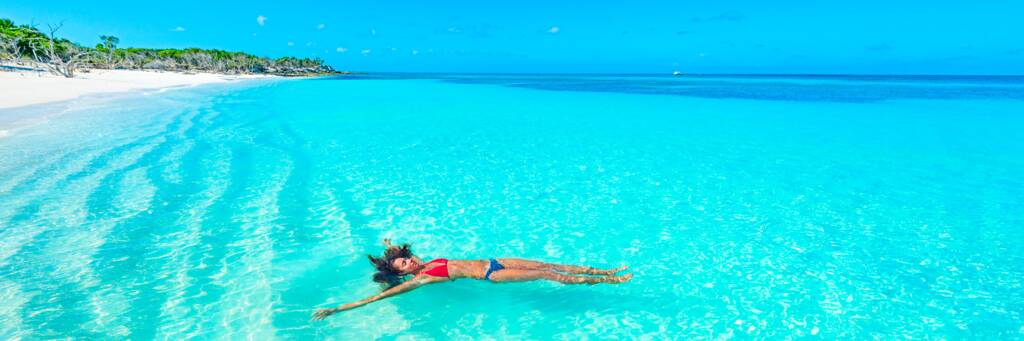 floating in the amazing clear ocean water at Little Water Cay