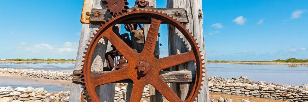 metal windmill pump gears on the salinas of South Caicos