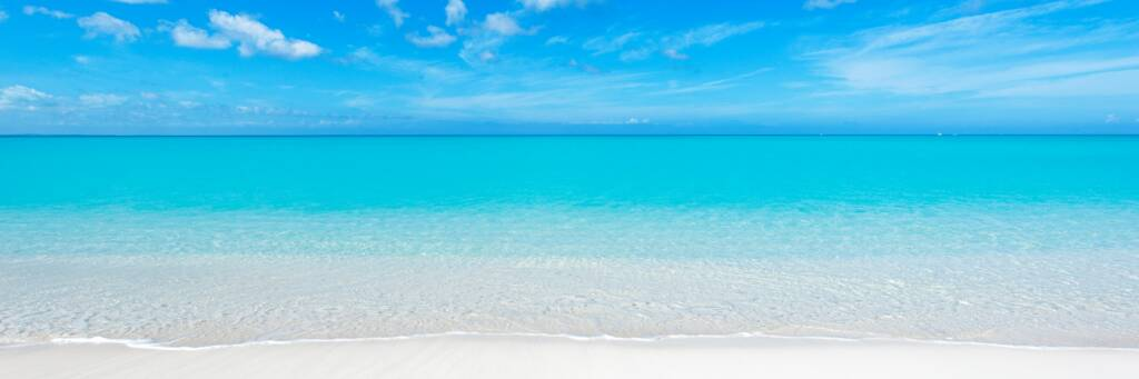 turquoise ocean and white sand at Grace Bay Beach