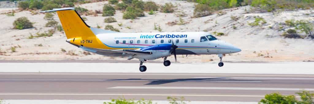 interCaribbean twin-engine turbo prop aircraft landing at Providenciales International Airport
