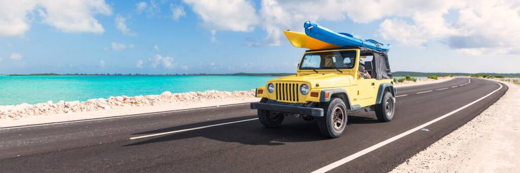 Jeep Wrangler with kayaks on the North Caicos and Middle Caicos Causeway