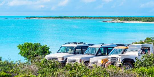 Land Rover Defender and Discovery 4x4s at West Harbour Bluff on Providenciales, Turks and Caicos