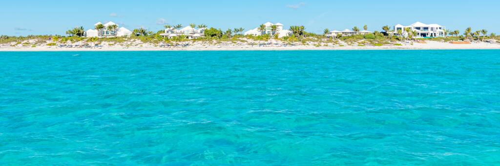 turquoise water and luxury homes at Long Bay Beach in the Turks and Caicos