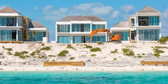 beachfront luxury villa construction at Long Bay Beach