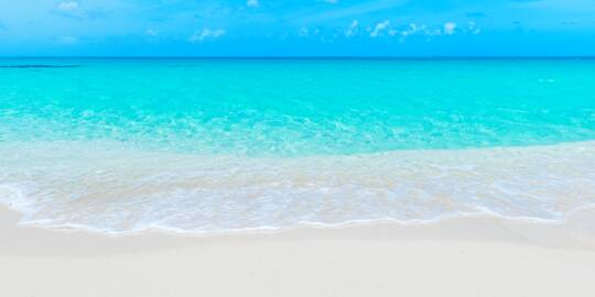white sand and turquoise ocean at North Bay Beach