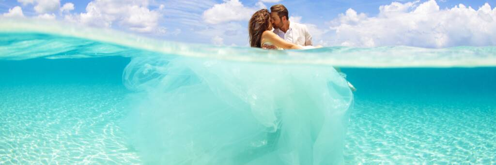 overunder photo of bride and groom at Grace Bay