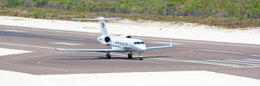 private jet on the runway at the Providenciales International Airport