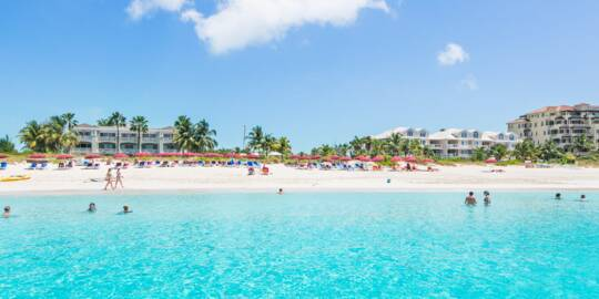 people enjoying the spectacular Grace Bay Beach in the Turks and Caicos