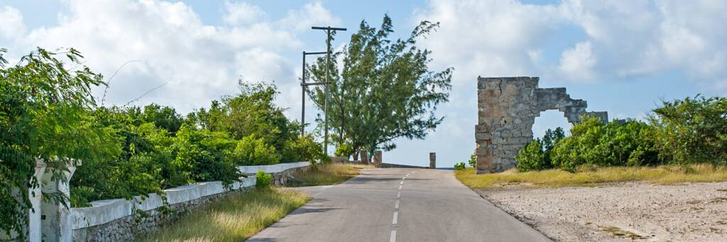 road and ruins of old limestone salt warehouse on South Caicos