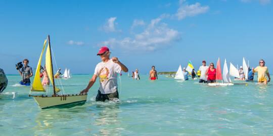 model Caicos Sloop races at Bambarra Beach on Middle Caicos