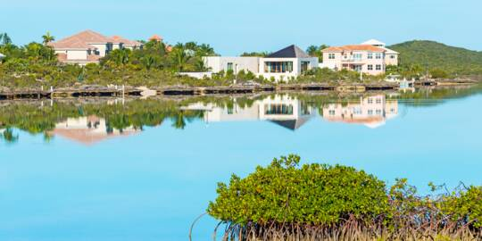 calm water and luxury villas at Silly Creek in the Turks and Caicos