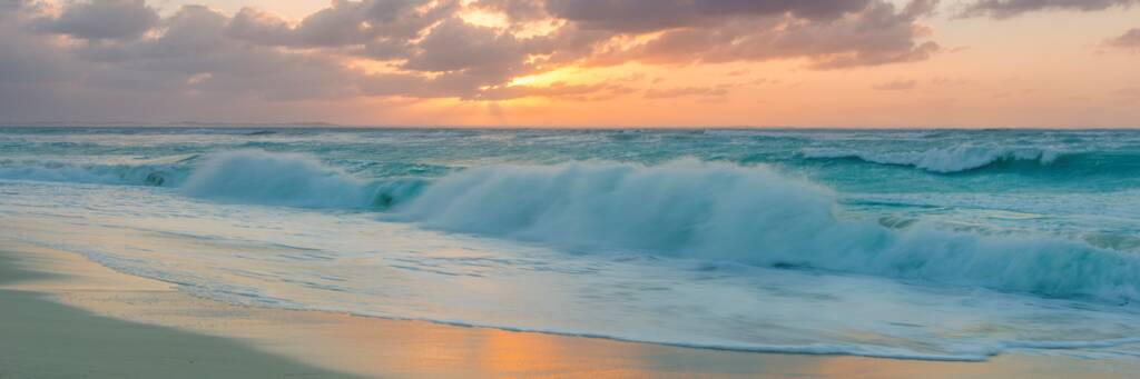 sunset and breaking waves at Leeward Beach in the Turks and Caicos